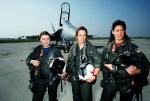 Women pilots of Tactical Electronic Warfare Squadron 34 (VAQ-34) pose for a photograph in front of an F/A-18A Hornet aircraft.